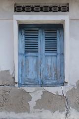 An old blue window