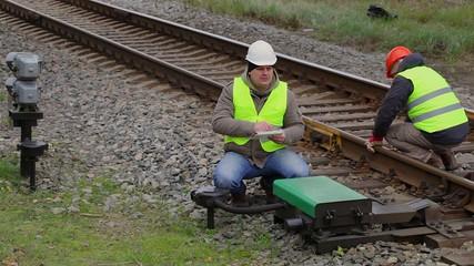 Railway employees performing maintenance on the railway