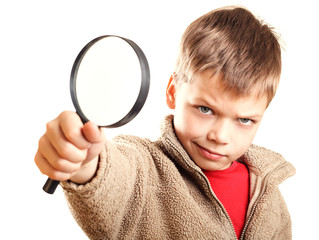 Little boy with magnifier