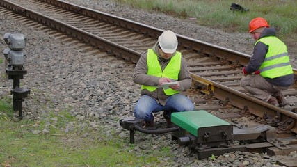 Two railway employees performing maintenance