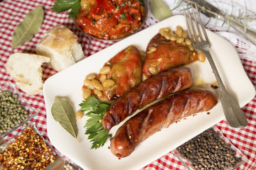 Fried sausages with beans and peppers