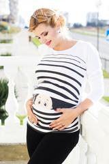 Pregnant girl is walking in park