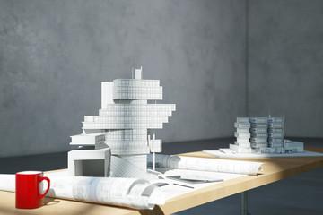 Grundriss und Architekturmodelle im Büro