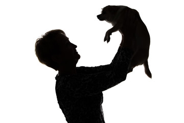 Photo of a woman's silhouette with the dog