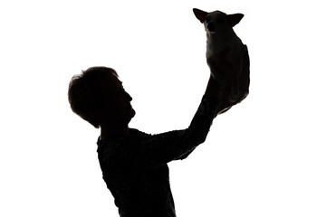 Image of a woman's silhouette with the dog