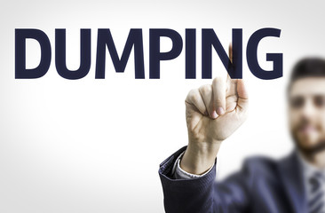 Business man pointing the text: Dumping
