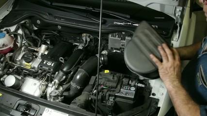 Car Repair Mechanic Assembles Automobile Air Filter