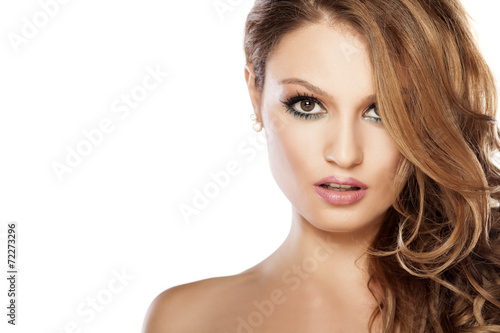 Portrait of beautiful young woman on white background - 72273296