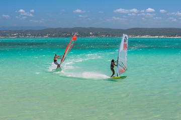 Couple windsurfers in the lagoon