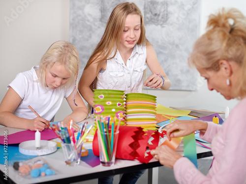 Leinwanddruck Bild Kids making lamps for St. Martins Day