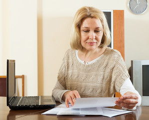 Blonde woman with documents