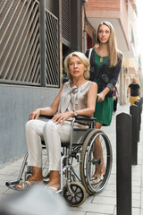 Social worker and disabled woman at stroll