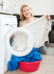Home laundry. woman using washing machine at home