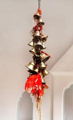 A bunch of small metallic bells in Naina Devi Temple at Nainital