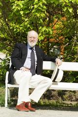 Elderly business man has relax in park