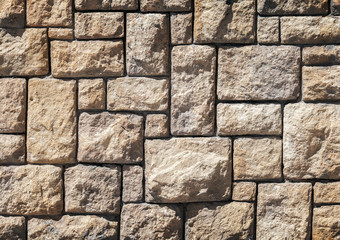 Background texture of old brown decorative stone wall