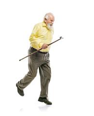 Happy old bearded man walking