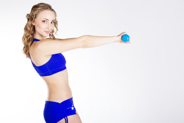 Young woman with blue dumbbells