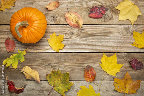 weathered wood background with leaves
