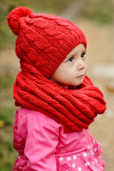 girl wearing red scarf and hat