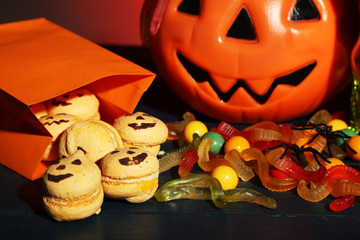 Composition for Halloween with sweets on dark background