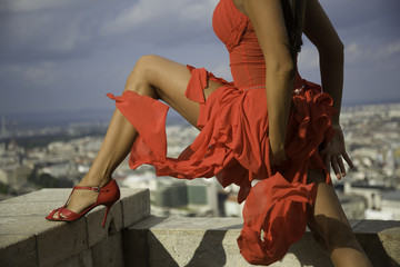 Sexy red dressed woman body torso over the city