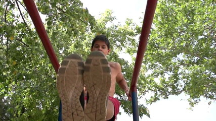 teenager practicing on the uneven bars, slow motion 1