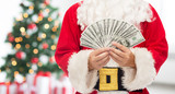 Fototapety close up of santa claus with dollar money