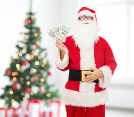 man in costume of santa claus with dollar money