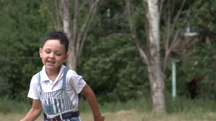 little boy running across the field to the camera, Slow Motion 2