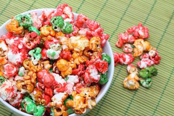 Colorful sugared popcorn in white bowl