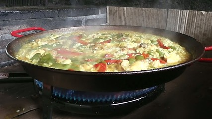 Spanish traditional food Paella cooking boling