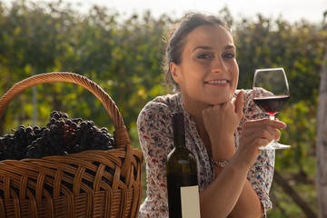 Female Enjoying In Vineyard