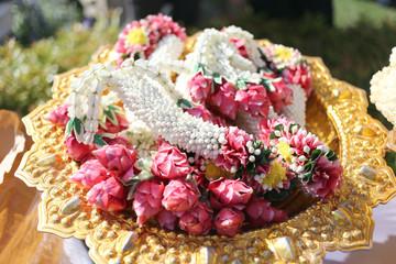 Garland of flowers in utensil.