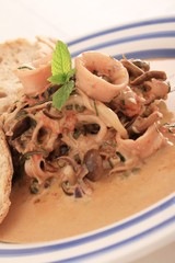 squid soup in bowl with ciabatta bread