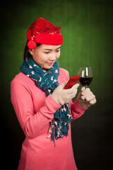 Asian girl with christmas hat ,wine and mobile phone