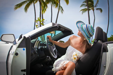 Beautiful young woman resting in her car