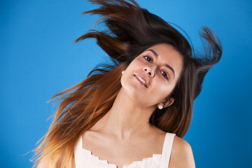 Woman moving her hair