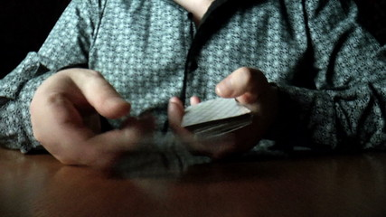 The video shows hands shuffle cards