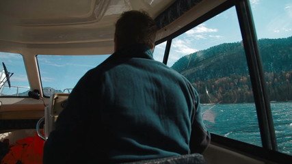 Man controls the boat