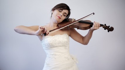 Bride to Be Playing Violin in her Wedding Dress