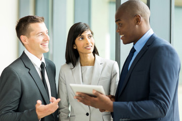 multiracial businesspeople working on tablet pc