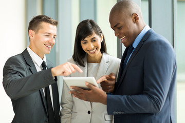 business team using tablet computer