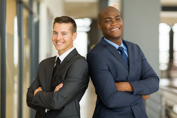 young businessmen with arms crossed