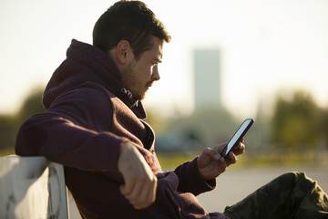 Attractive Man Holding The Mobile Phone