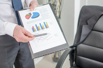 Businessman showing financial graphs