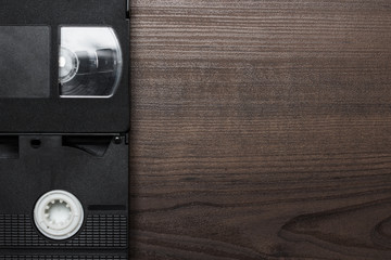 old retro video tapes over wooden background
