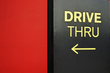 yellow drive thru text with arrow