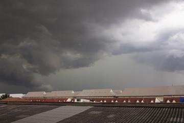 Dark stormy clouds over the village in Thailad