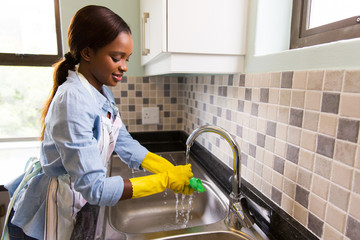 african american woman doing house chores